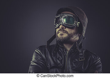 motivation pilot dressed in vintage style leather cap and goggle