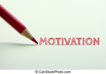 Motivation word is standing on the paper with red pencil...