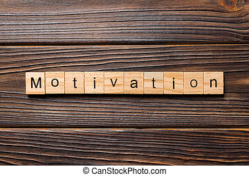 Motivation word written on wood block. Motivation text on wooden table for your desing, concept