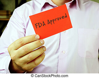 Motivational concept meaning FDA Approved with sign on the page.