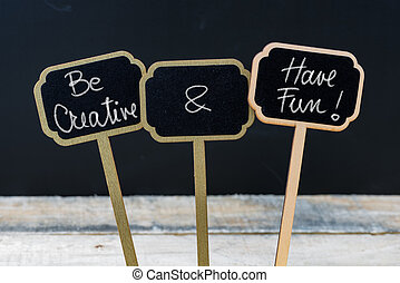 Motivational message Be Creative and Have Fun written with chalk