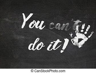 motivational sign on black chalkboard