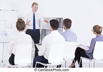 Motivational training for employees - Handsome man standing...
