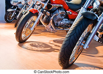 Front of powerful motorcycles aligned for sale