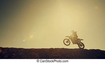 Motocross Biker Jumping - Motocross bikers jump throw the...