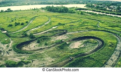 Motocross motorcycles training on a track, aerial view