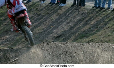 Motocross on dusty road