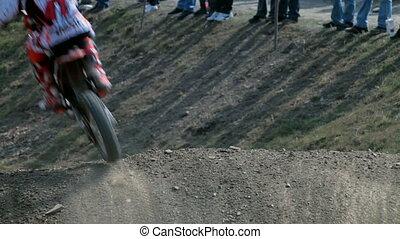 Motocross on dusty road - bikers race in dry, dusty...