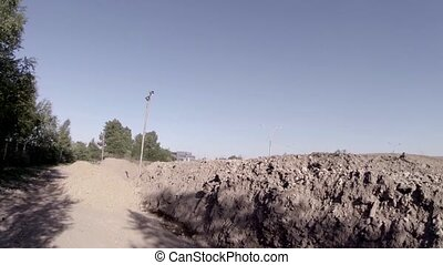 racer jumping on a motorcycle - Motocross racer jumping on a...