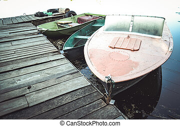 Motor boat and ordinary boats on the pier