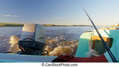 Motor boat in river at sunset 4k - Close-up of motor boat in...