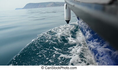 Motor boat in sea. Clear water
