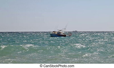 Motor boat on sea waves