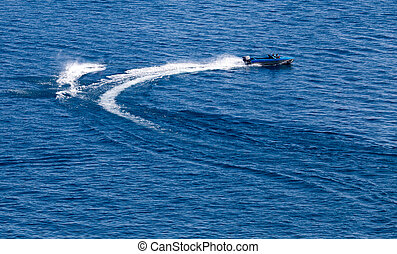 motor boat on the water at a speed of