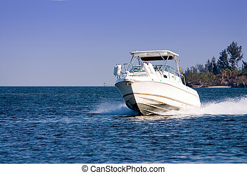Pleasure boat cruising river