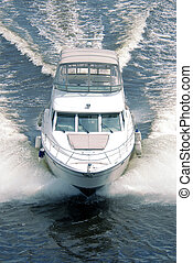 The motor boat goes on the big speed on waves.