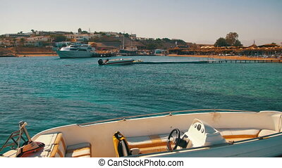 Motor Boat Tied to a Pier in the Red Sea near the Beach - ...