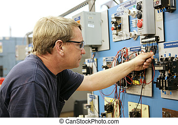 Motor Control - A vocational education teacher wiring a...