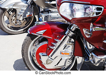 motor cycle engine and bike reflected in a chromium-plated...
