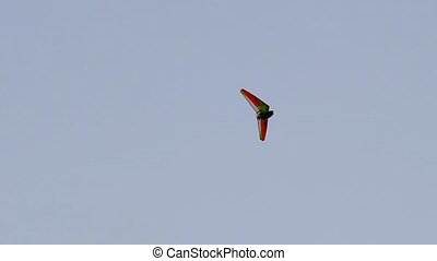 motor paraglider flying in the blue sky. flying hang-glider...