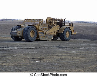 motor scraper - earthmoving machine at a job-site