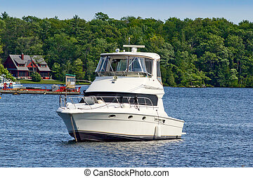 Motor yacht at a cottage