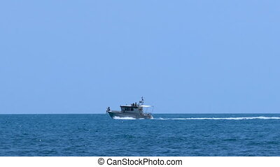 Motor yacht in the sea - Motorboat is moving rapidly along...
