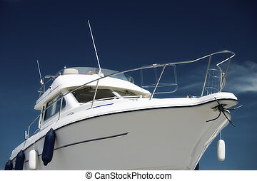 Motor yacht  - Side view of a yacht under deep blue sky