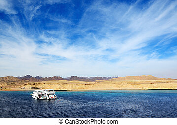 Motor yachts and snorkeling tourists in Ras Muhammad...