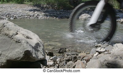 motorbike crossing creek water splashing
