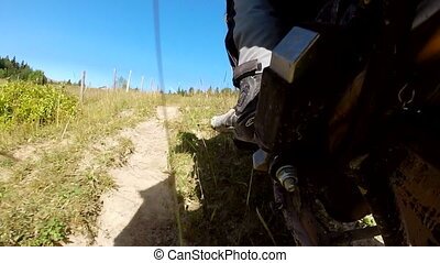 Motorbike driving along the country road