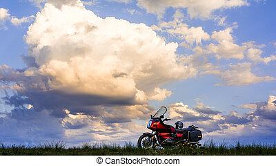 motorbike on flat hill under cloudy sky