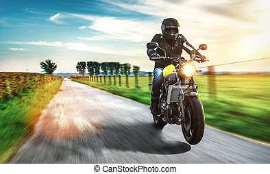 motorbike on the road riding. having fun driving the empty road on a motorycle tour journey. copyspace for your individual text.