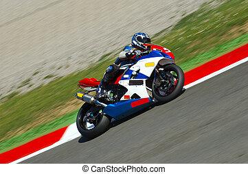 Motorbike Racing - A motorbike racing, visible panning