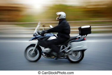 motorbike rider in high speed