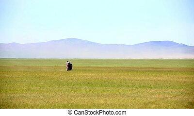 motorbike riding in Mongolian landscape