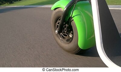 Motorbike wheel and asphalt. Road at daytime. New model of...