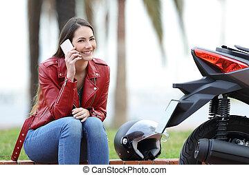 Motorbiker calling insurance after breakdown