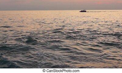 Motorboat Black Sea at sunset