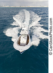 Motorboat - Fast motorboat with splash and wake on an ocean