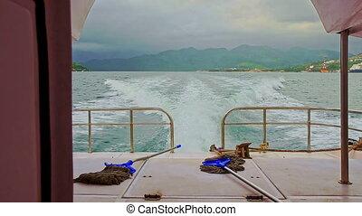 Motorboat Foamy Track on Azure Sea against Distant Hills -...