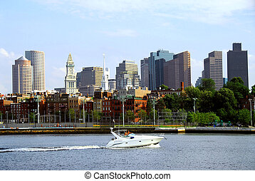 Boston skyline - Motorboat in a harbor in front of a Boston...