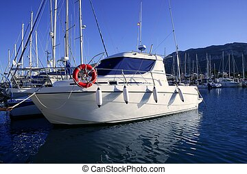 Motorboat in blue Mediterranean marina - Sport fishing...