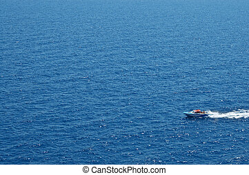 motorboat on blue sea closeup