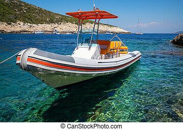 Motorboat on clear ocean water in Hvar, Croatia.