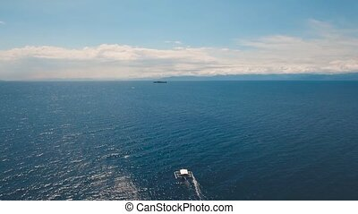 Motorboat on the sea, - aerial footage motorboat in blue...