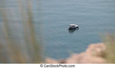 motorboat sailing along seashore - motorboat sailing along...