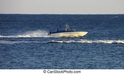 Motorboat - Speed motorboat is moving at sea