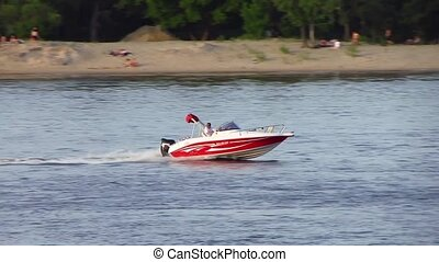 Motorboat - Speed motorboat is moving rapidly along the...