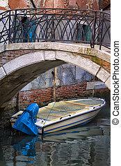 Motorboat Under a Bridge in Venice